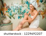 beautiful young woman sitting... | Shutterstock . vector #1229692207