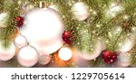 christmas background with balls.... | Shutterstock .eps vector #1229705614