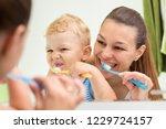 beautiful mother helping her...   Shutterstock . vector #1229724157