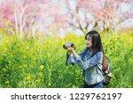 woman take a yellow flower... | Shutterstock . vector #1229762197