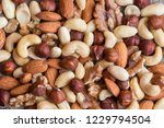 various mixed nuts background | Shutterstock . vector #1229794504
