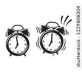 black and white alarm clock... | Shutterstock .eps vector #1229808304