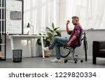 man throwing trash in basket in ... | Shutterstock . vector #1229820334