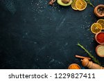 colored spices on a black stone ... | Shutterstock . vector #1229827411