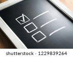 checklist on chalkboard. agenda ... | Shutterstock . vector #1229839264