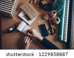 women writing something down at ... | Shutterstock . vector #1229858887