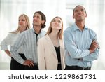 young business team looking at... | Shutterstock . vector #1229861731