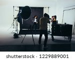 photographer shooting photos of ... | Shutterstock . vector #1229889001