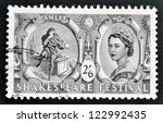 Small photo of UNITED KINGDOM - CIRCA 1964: A stamp printed in Great Britain dedicated to Shakespeare Festival, shows Hamlet contemplating Yorick's skull (Hamlet) and Queen Elizabeth II, circa 1964