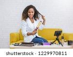 portrait young black woman... | Shutterstock . vector #1229970811