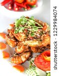 shrimps fried with chilies and... | Shutterstock . vector #1229984074