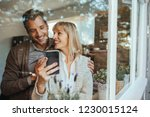 husband and wife using... | Shutterstock . vector #1230015124