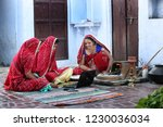 three traditional indian young...   Shutterstock . vector #1230036034