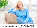 beautiful smiling woman sitting ... | Shutterstock . vector #1230046507