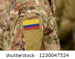 colombia flag on soldiers arm.... | Shutterstock . vector #1230047524