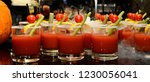 a cocktail of tomato juice in a ... | Shutterstock . vector #1230056041