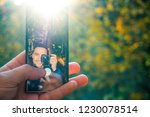 man taking selfie in the woods... | Shutterstock . vector #1230078514