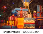 gift boxes in front of the tree | Shutterstock . vector #1230110554