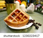 a slide of waffle with resins... | Shutterstock . vector #1230223417