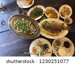 different thai dishes on a table | Shutterstock . vector #1230251077