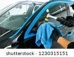 car polish wax worker hands... | Shutterstock . vector #1230315151