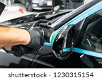 car polish wax worker hands... | Shutterstock . vector #1230315154
