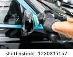 car polish wax worker hands... | Shutterstock . vector #1230315157
