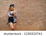 happy young hipster woman...   Shutterstock . vector #1230323761