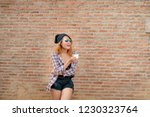 happy young hipster woman...   Shutterstock . vector #1230323764