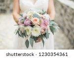 wedding bouquet in bride's... | Shutterstock . vector #1230354361