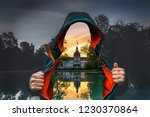 Man with open jacket. Instead of the body you can see the castle philipsruhe in Hanau and the reflection in the lake. the natural background is gray. Photoshop mood