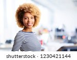 a laughing young businesswoman...   Shutterstock . vector #1230421144