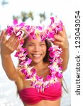 hawaii woman showing flower lei ... | Shutterstock . vector #123043054