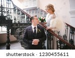 bride and groom are standing on ...   Shutterstock . vector #1230455611