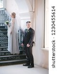 bride and groom are standing on ...   Shutterstock . vector #1230455614