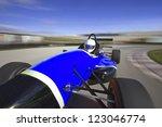 Blue Racing Car Driving At Hig...