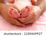 newborn baby foot   Shutterstock . vector #1230469927