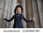 beautiful blonde in a black...   Shutterstock . vector #1230486784
