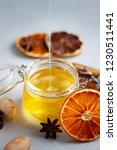 closeup view of honey being... | Shutterstock . vector #1230511441