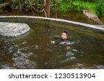 image of asian boy swimming in... | Shutterstock . vector #1230513904