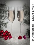 two glasses with champagne  and ... | Shutterstock . vector #1230517414