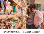 young couple shopping in... | Shutterstock . vector #1230538084