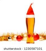 full pilsner glass of pale... | Shutterstock . vector #1230587101