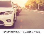 car on the road close up front... | Shutterstock . vector #1230587431