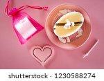 small birthday cake  next to... | Shutterstock . vector #1230588274
