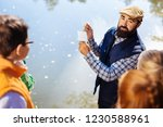 outdoor lesson. nice bearded...   Shutterstock . vector #1230588961