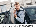 young businessman talking on... | Shutterstock . vector #1230604771