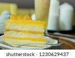 piece of orange cake with... | Shutterstock . vector #1230629437