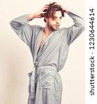 sexy macho in blue bathrobe or... | Shutterstock . vector #1230644614