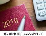 close up of 2019 diary with pen ... | Shutterstock . vector #1230690574